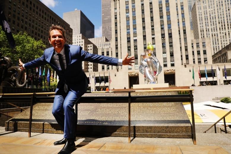 E Jeff Koons' 45-Foot Tall Nylon Sculpture Of Seated Ballerina Goes On Display In Rockefeller Center